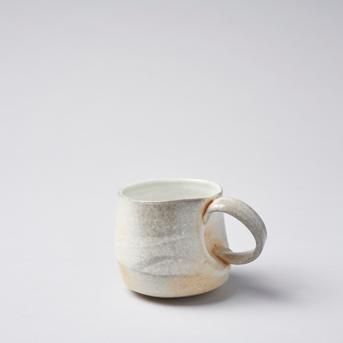 Soda fired tea cup with twisted handle