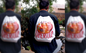 Alecs models the ramensoup drawstring backpack.