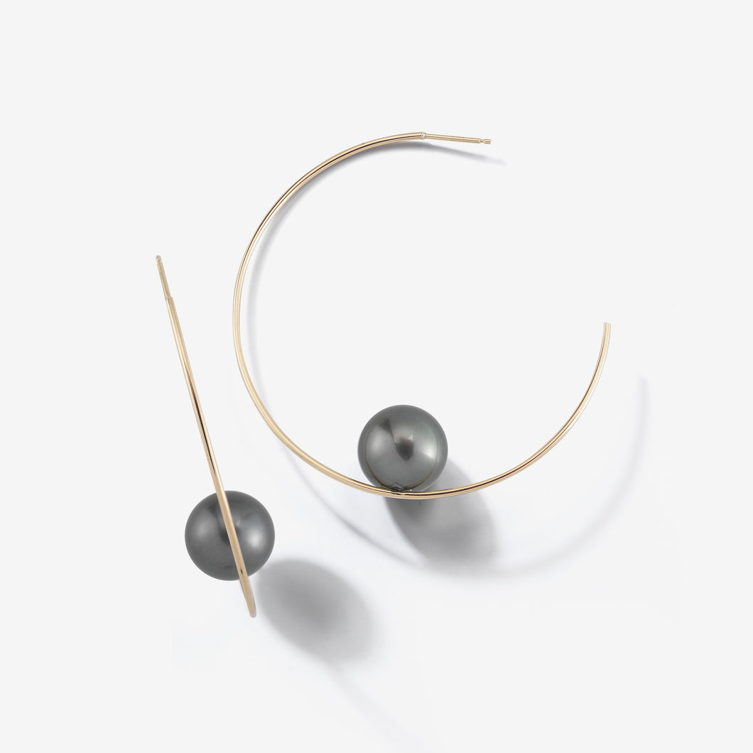 Sea of Beauty Collection.  Floating Black Pearl Hoop Earring