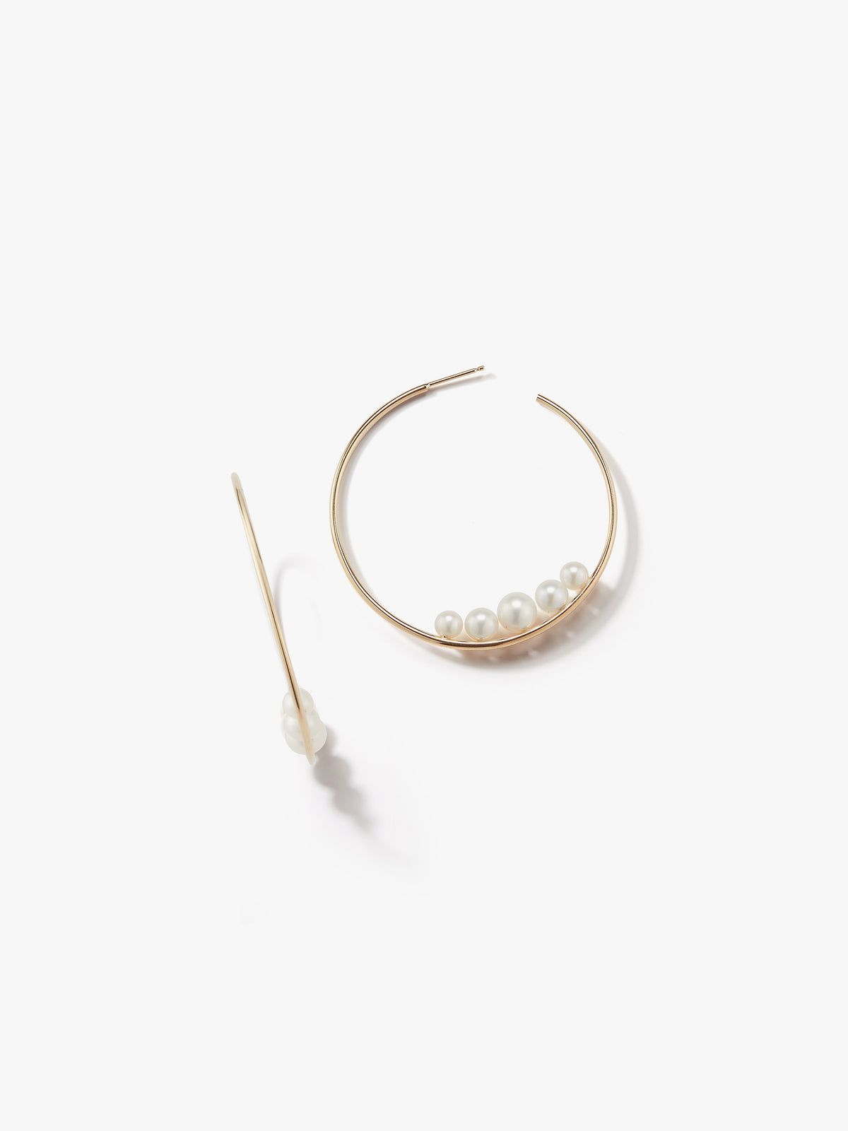 Sea of Beauty Collection.  Medium Graduating Floating Pearl Hoop Earring