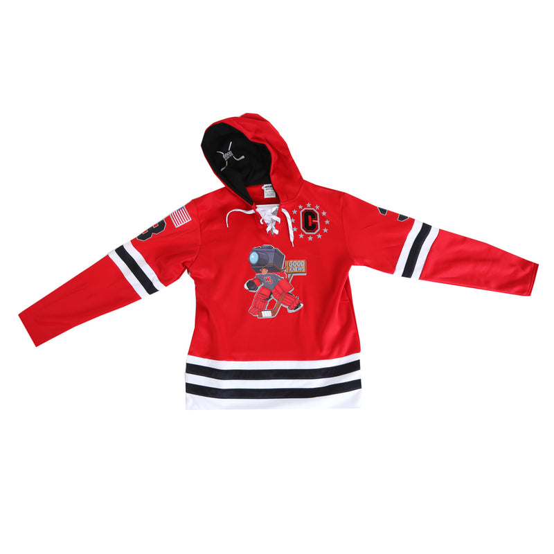 Pictured from the front: GoodKnews Presents: Red Knuckle Puck Hockey Jersey Hoodie. Hooded jersey available in red with designs on the front, sleeves, and back.