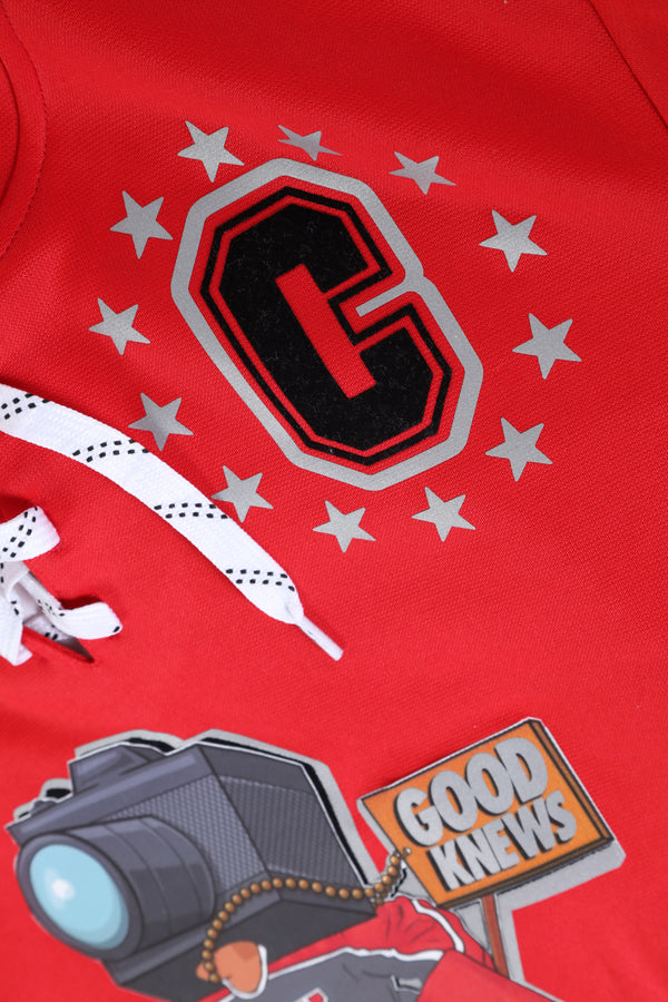 Close-up of chest designs on the Red GoodKnews Knuckle Puck Hockey Jersey Hoodie.