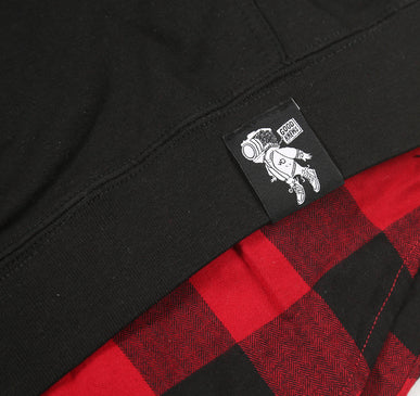 Logo details. GoodKnews Presents: Accomplished Not Cocky Flannel-Hoodie Combo. Available in a black hoodie with C.A.M accents and Accomplished Not Cocky on the front, and a red and black flannel underneath.