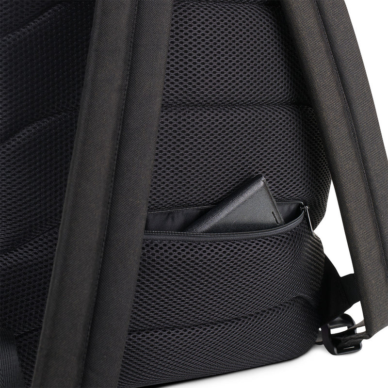 Closeup of the back zipper pocket on the Welcome to Springfield C.A.M backpack.