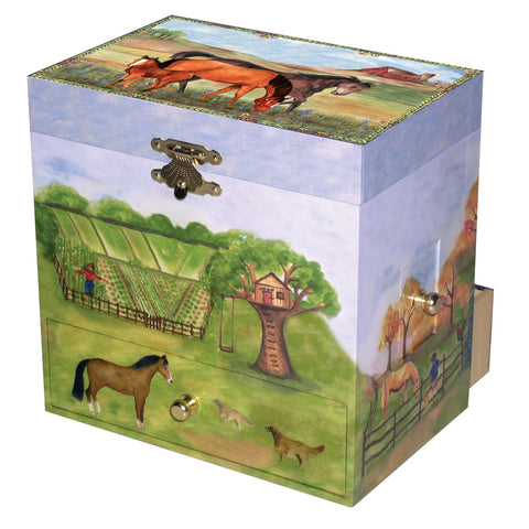 a mare and foal with their stallion friend out in a ranch field | kid's music box with four secret drawers for treasure storage from Enchantmints