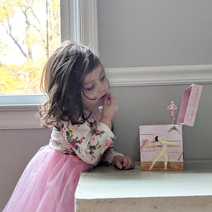 Ballet School Music box with young girl in tutu | A ballerina is on top in pink with a posey and morning glories around her.  Scenes from the ballet studio are on the side.  Watercolor illustrations and 4 secret corner treasure drawers | Pretty musical gifts for kids from Enchantmints