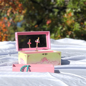Ballet Shoes Music box open in sunshine | Two ballerinas getting ready for a recital.  Ballet shoes are on the side.  Watercolor illustrations and hidden treasure compartment inside | Pretty musical gifts for kids from Enchantmints