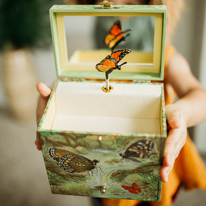 Monarch butterfly music box close up in girl's hands view | Musical treasure boxes and decor for kids from Enchantmints | unusual gifts for girls