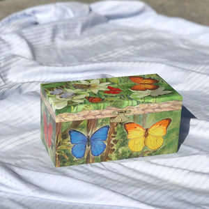 Butterfly music box closed out in sunshine | Musical treasure boxes and decor for kids from Enchantmints | unusual gifts for girls