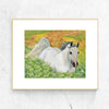 Watercolor painting of white horse in green and yellow field of wildflowers hanging on marbled white wall in a wooden frame | Printable wall art for children from Enchantmints.
