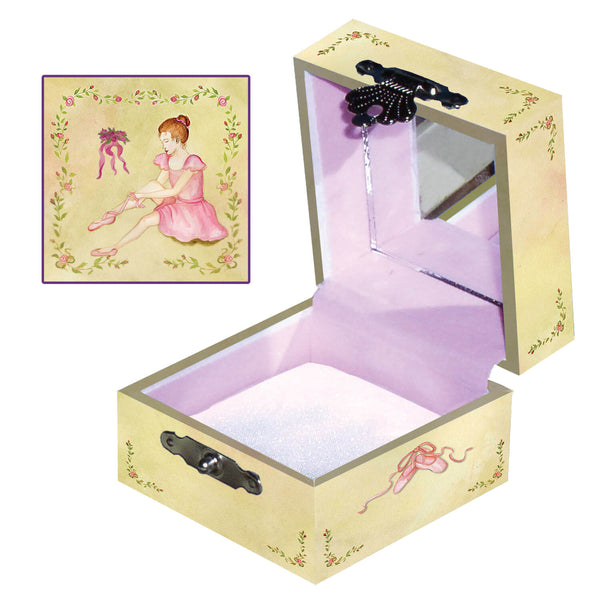 Ballet shoes tiny treasure box side and top view | A ballerina is putting on her ballet shoes on the top and a gentle yellowgreen tint decorates the sides | Pretty unique gifts for kids from Enchantmints