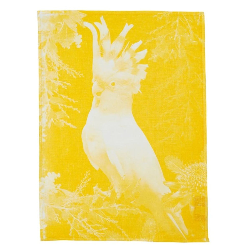 Tea Towel with a white boarder featuring a yellow square including a cockatoo, wattle and banksia