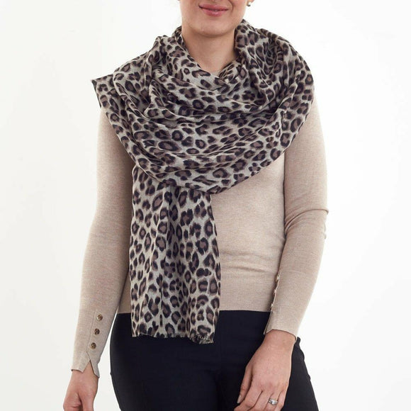 Wool and Silk mix woven scarf with hand printed animal design and eyelash fringes.