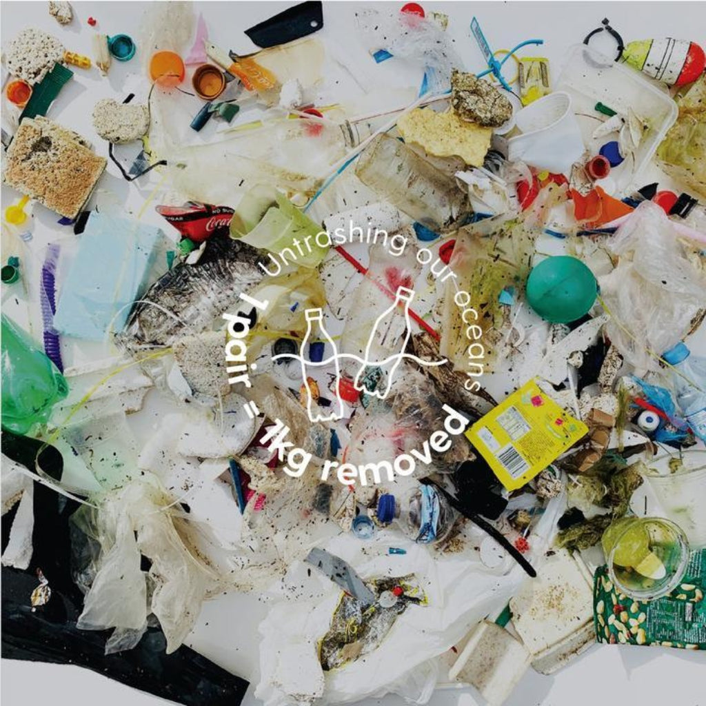 Image featuring various trash items with the text - Untrashing our oceans, one pair equals one kg removed - overlayed on the top of the image