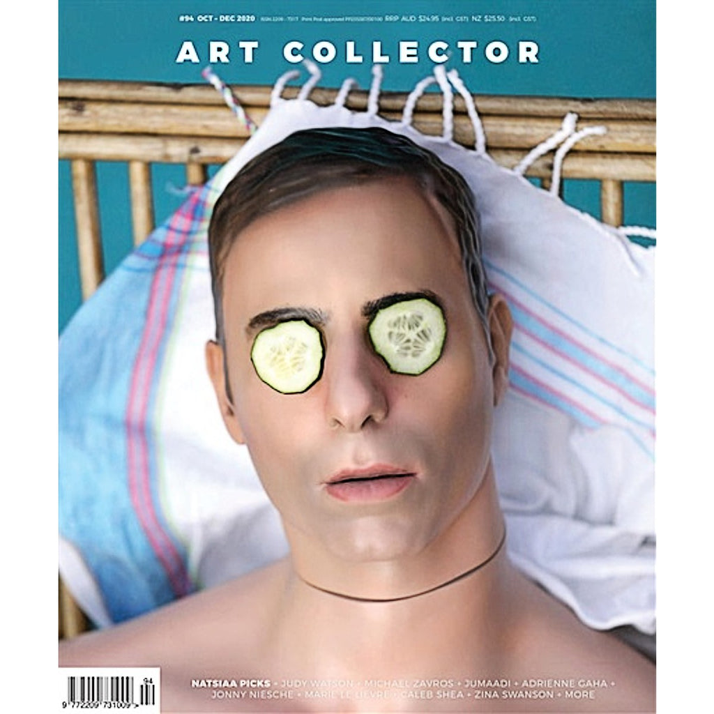 A magazine featuring a work by Michael Zavros. A hyper real image of a man face, he is reclining and has slices of cucumber covering his eyes
