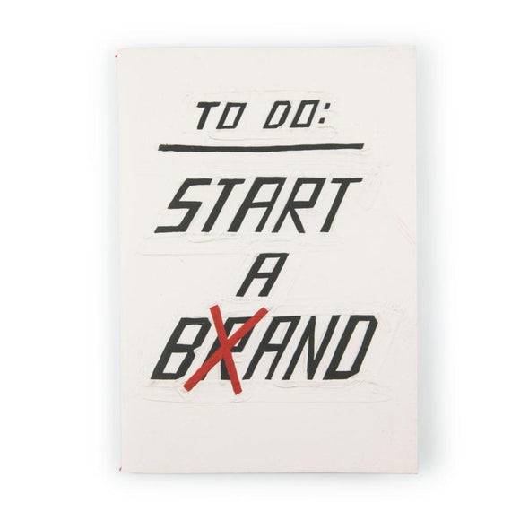 Notebook featuring the words To Do: Start a Brand