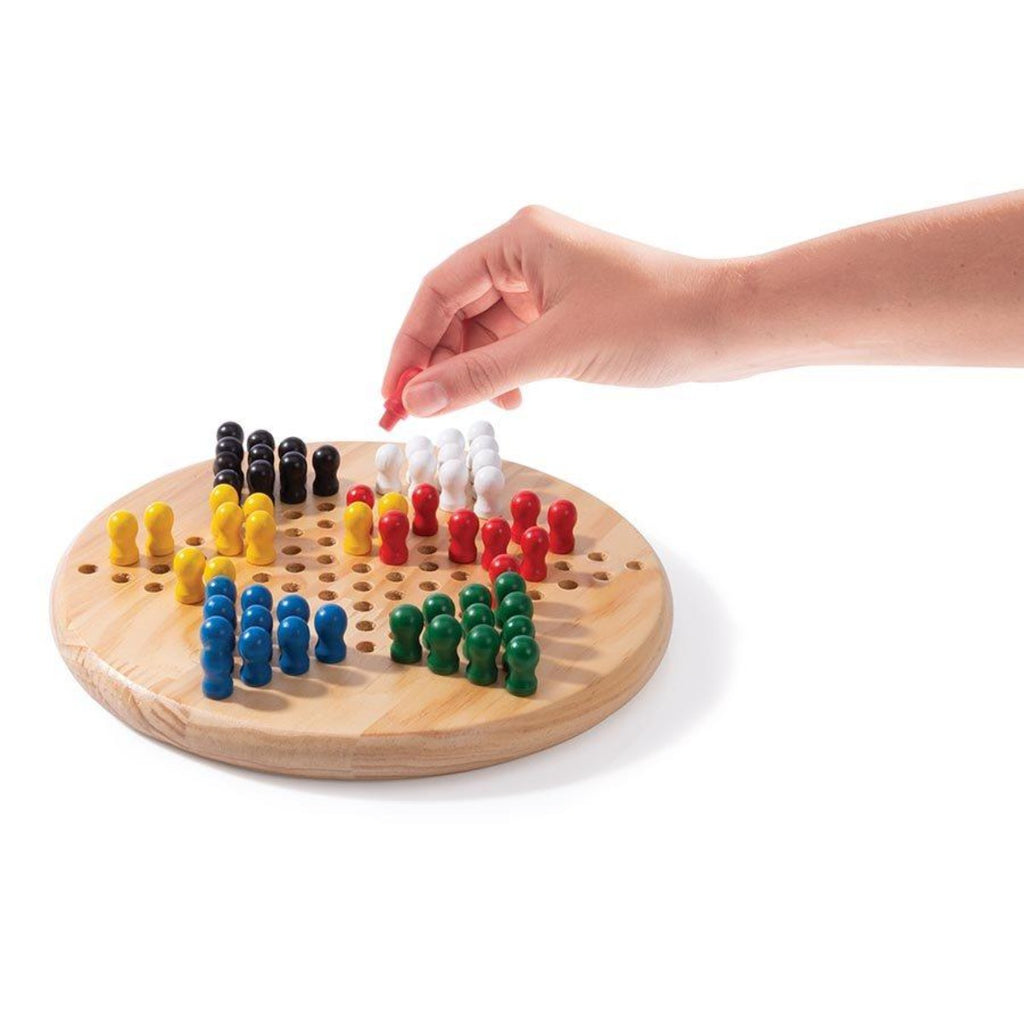 Image featuring a hand placing a red peg within the round circle beechwood board