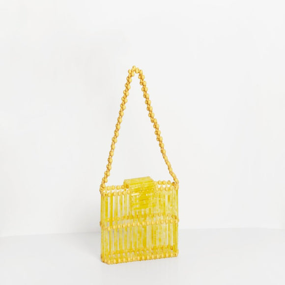 Bag with handle made out of resin in a yellow colour