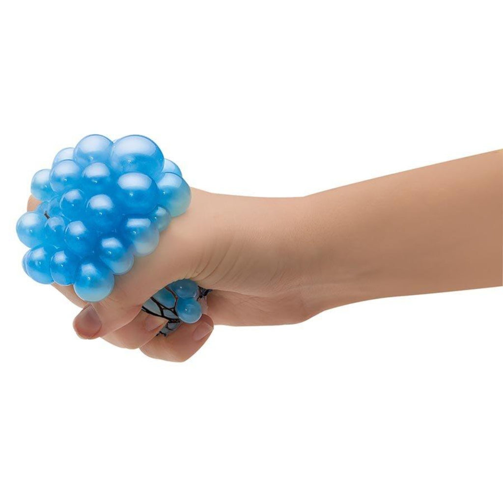 Image featuring a hand squeezing a completed atomic slime brain ball