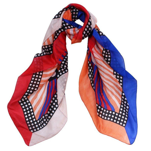 a fashionable lightweight silk square scarf which features a Coral, Red, Cobalt and Black spots, stripes and border print and is finished with stitched edges.