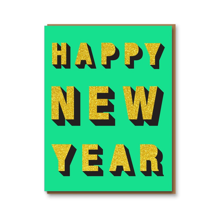 Image featuring a card with a green background with a glittery gold text stating Happy New Year