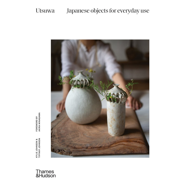 A book cover with a photograph of a ceramic vase and a blurred figure standing behind it.