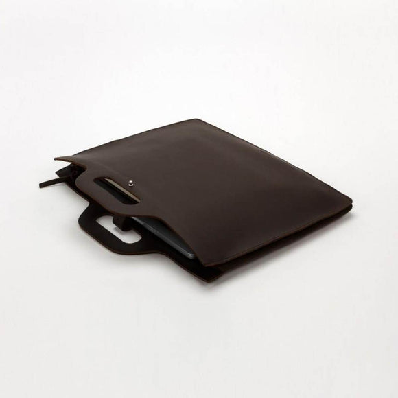 a cleanly designed, dark brown leather laptop bag in a satchel style with  a leather handle and closure.