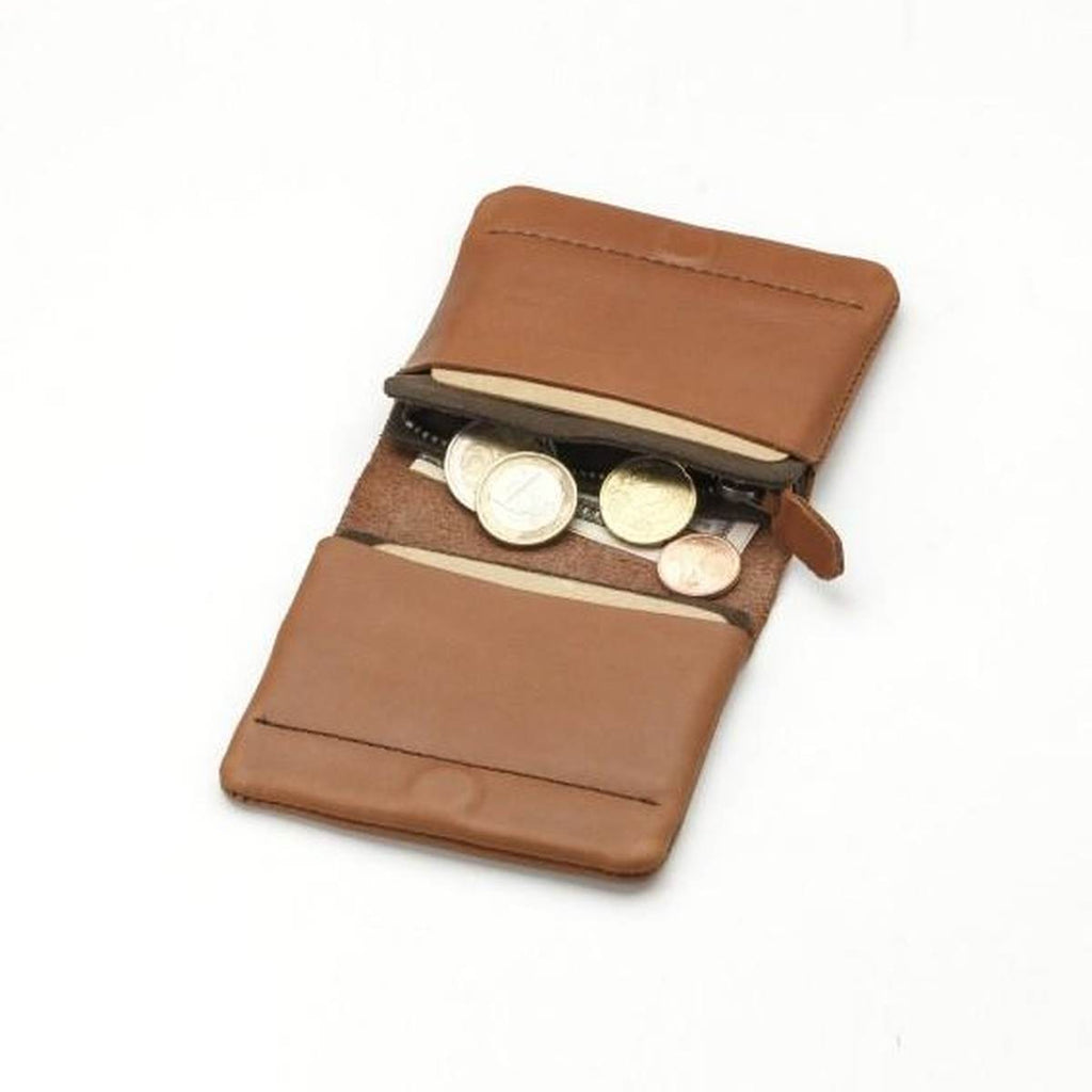 A small tan leather fold wallet. Shown open displaying two card pockets and a zip coin section. The wallet contains assorted cards and a bank notes and coins.