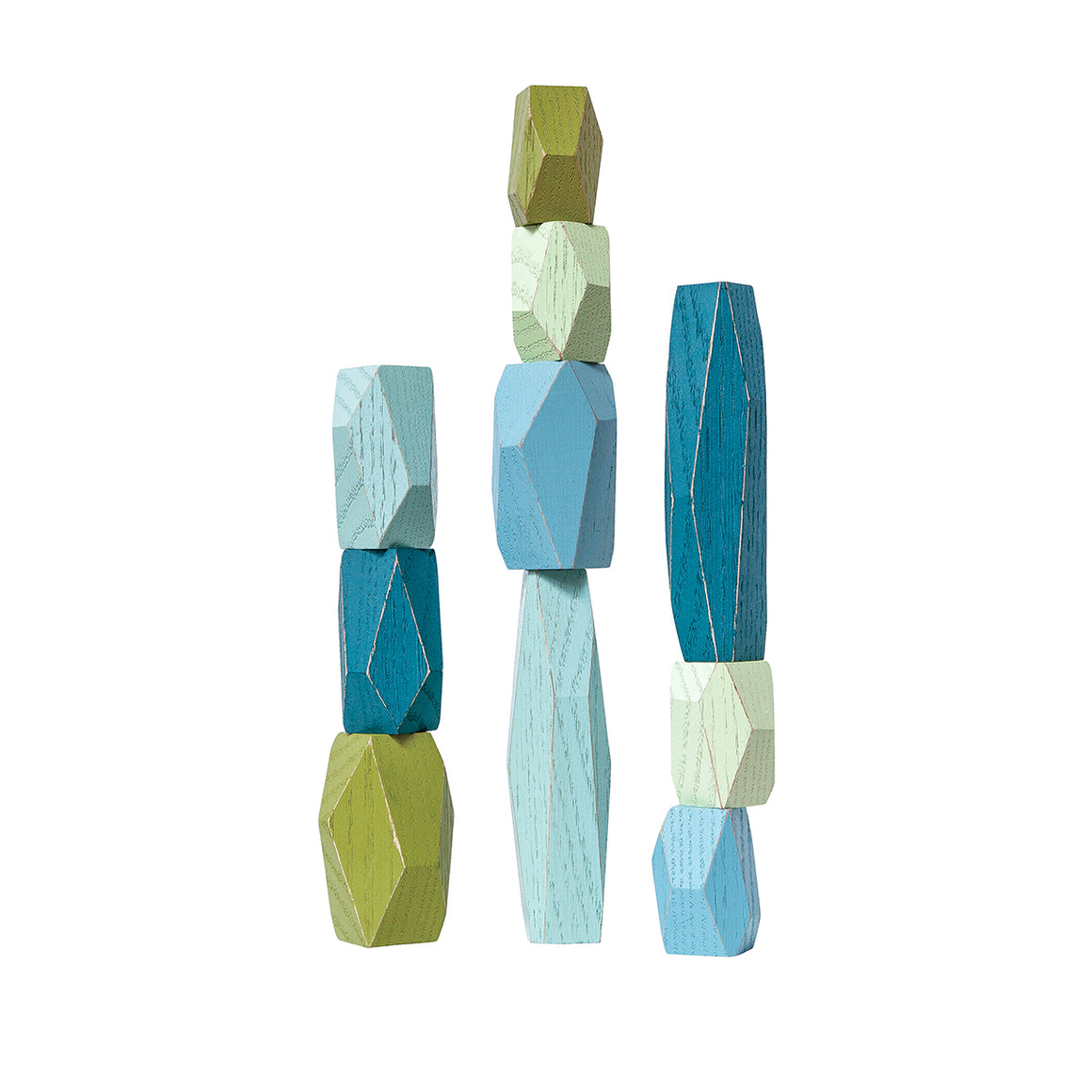 A set of ten faceted blocks made from oak wood and painted in a range of blue and green tones.