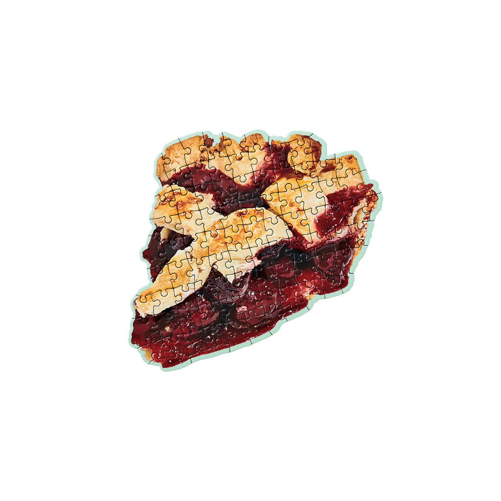 A small completed puzzle depicting a slice of american style cherry pie.