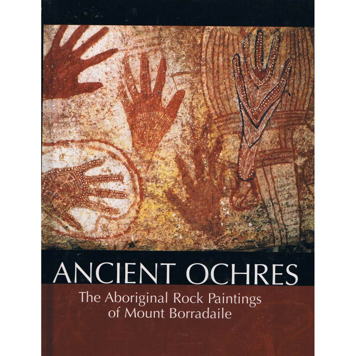 Book cover featuring a Aboriginal Rock Painting of hands including the words Ancient Ochres: Aboriginal Rock Paintings of Mount Borradaile