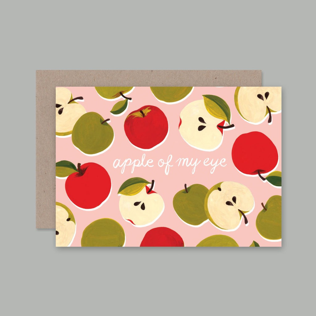 A6 Greeting card with a pink background with illustrations of apples on them and text in the middle stating - Apple of my eye