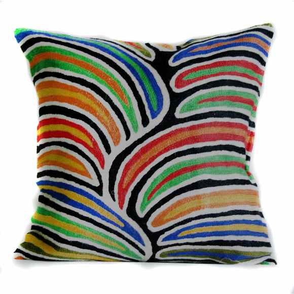 An embroidered wool Cushion featuring an Aboriginal Artwork in red, yellow, orange, green, blue, black and white tones. The design is made largely of colourful lines and shapes separated by black and white lines.