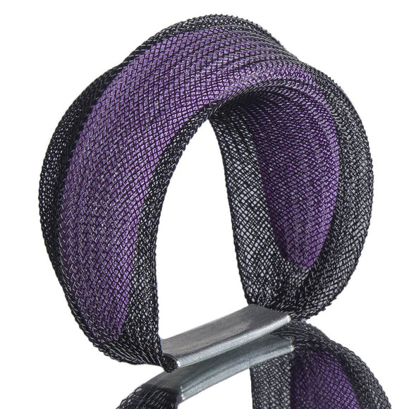 A black and purple bracelet made from finely woven nylon mesh. A purpler mesh tube in visible contained inside a black mesh tube.