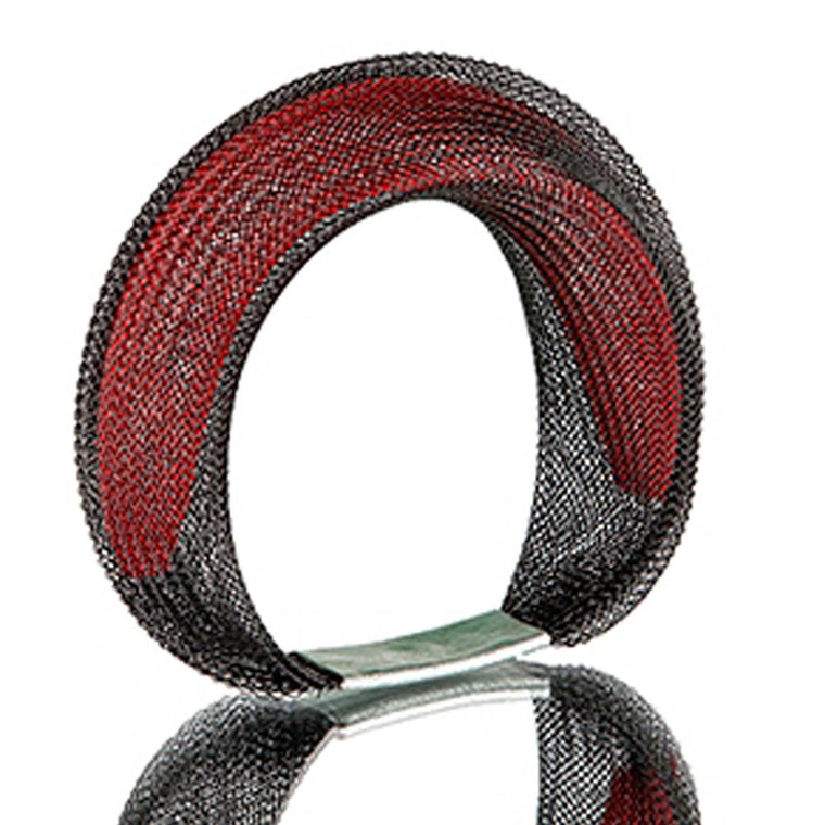 A Black and red bracelet made from finely woven nylon mesh. A red mesh tube is visible contained inside a black mesh tube.