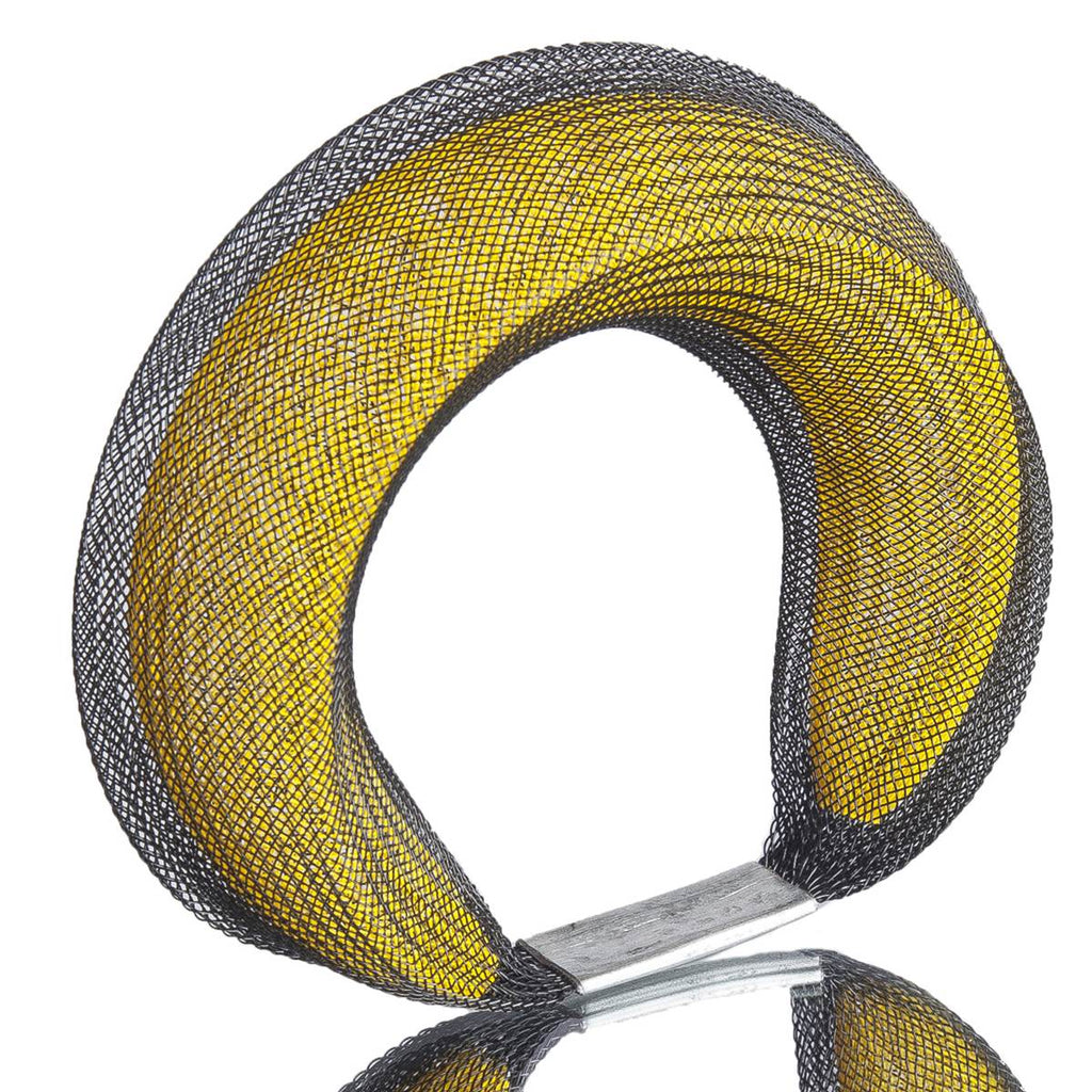 A Black and yellow bracelet made from finely woven nylon mesh. A yellow Mesh tube is visible contained inside a black mesh tube.