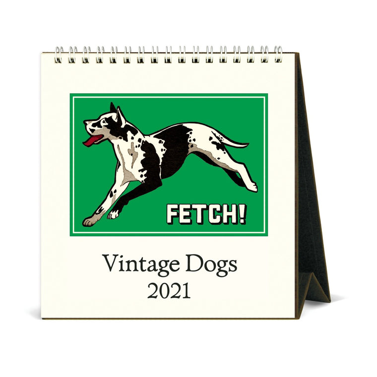 A small 2021 desk calendar, shown with easel stand open. The cover features a vintage dog image in bold colours.