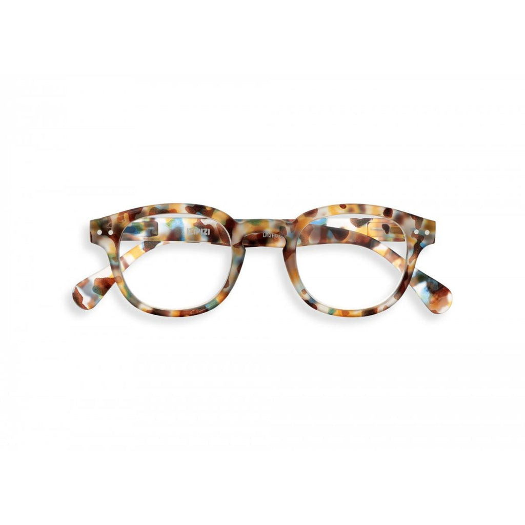 A pair of magnifying reading glasses. The frames are an stylish, bold, square shape in a mottled blue tortoise shell finish.