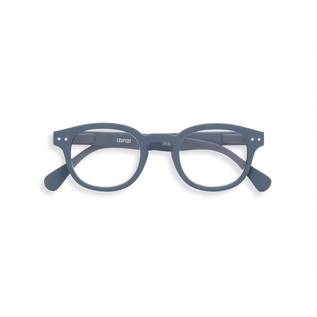 A grey pair of magnifying reading glasses. The frames are an stylish, bold, square shape.