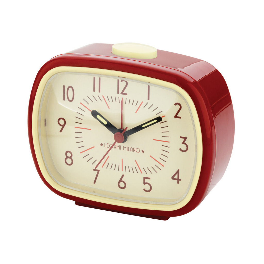 a retro inspired alarm clock in red and cream