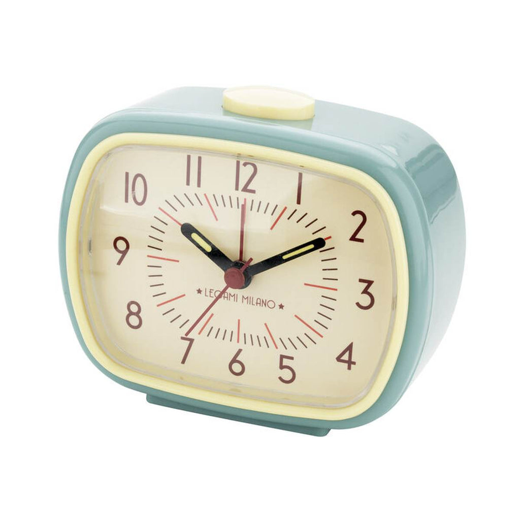 a retro inspired compact alarm clock in blue and cream.