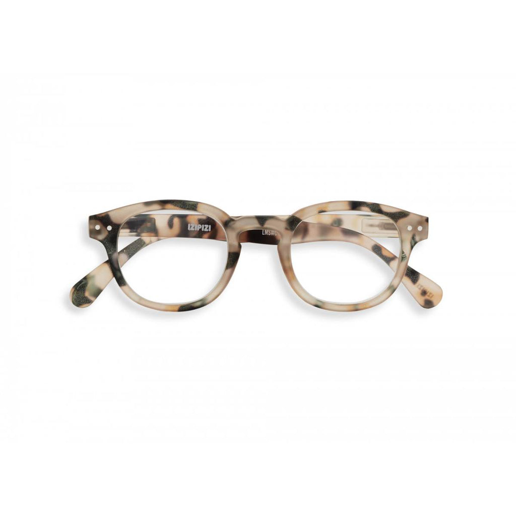A pair of magnifying reading glasses. The frames are an stylish, bold, square shape in a mottled light tortoise shell finish.