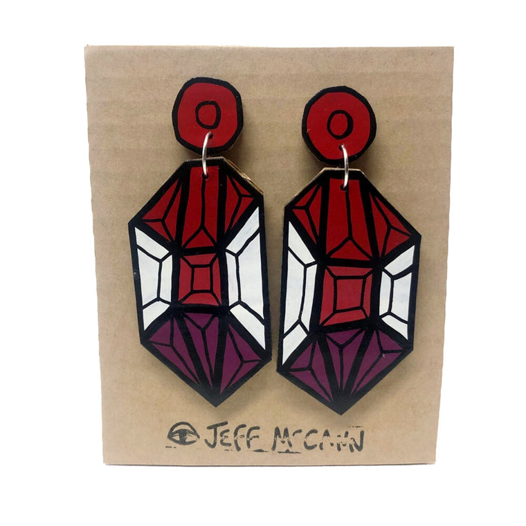A Pair of Drop Earrings made of hand painted cardboard. A geometric design in the shape of a crystal, in red tones and white.