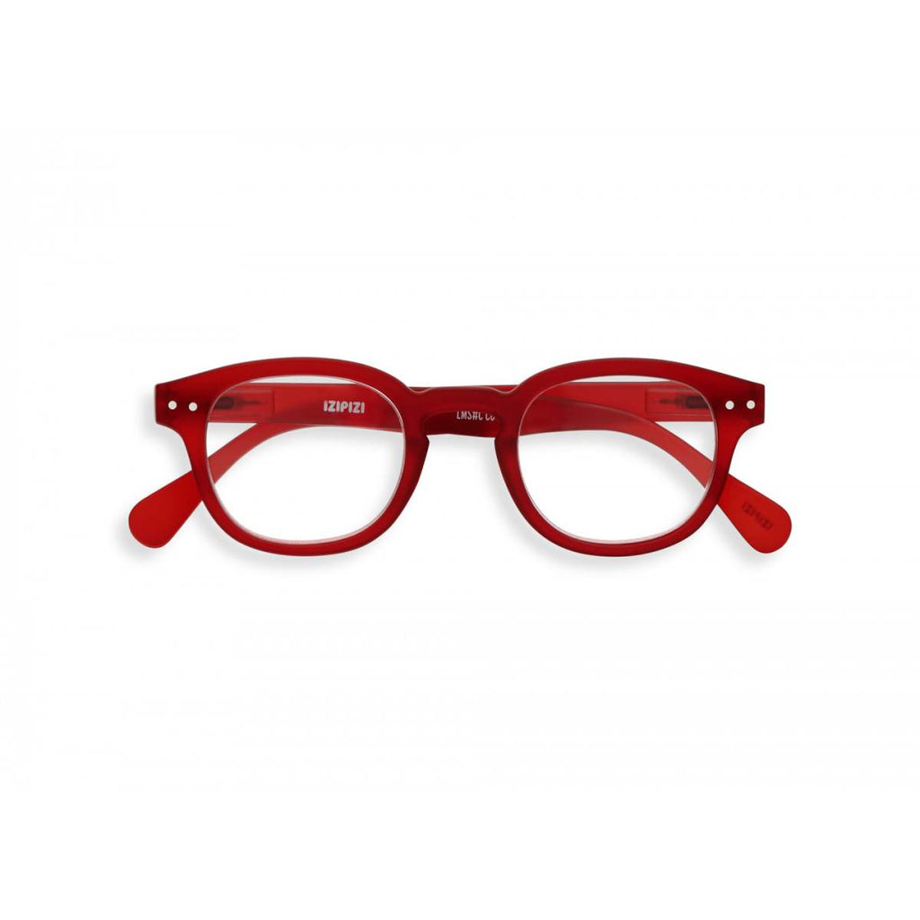 A slightly translucent red pair of magnifying reading glasses. The frames are an stylish, bold, square shape.