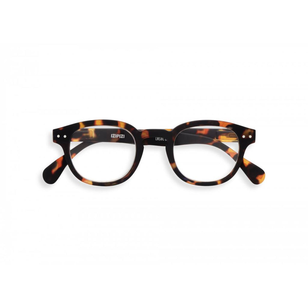 A pair of magnifying reading glasses. The frames are an stylish, bold, square shape in a mottled classic tortoise shell finish.