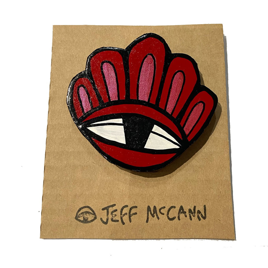 a Large Jeff McCann Brooch featuring  an eye and bloom like petals in Red, Pink, white and black
