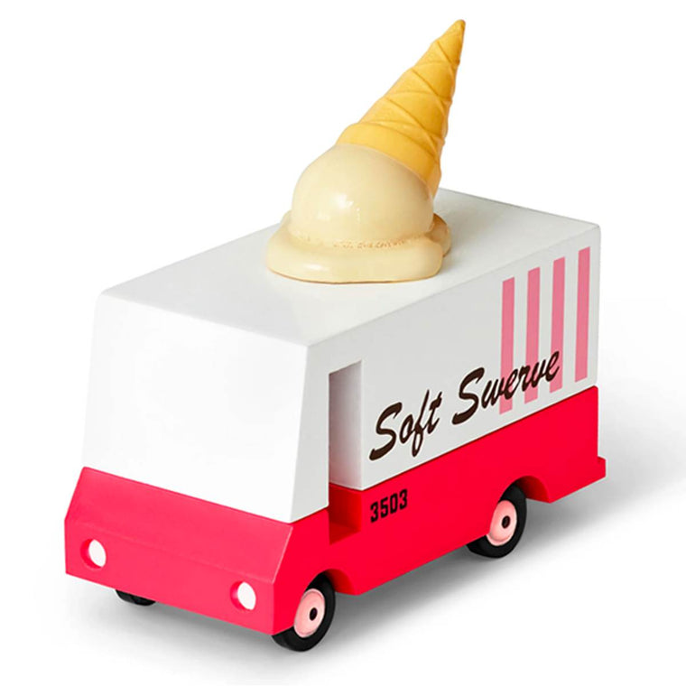 "A miniature wooden toy van. Created to  mimic New York Ice cream Food trucks, it features the slogan ""Soft Swerve"" is painted in Pink, white and brown, and has a miniature ice cream on its roof."