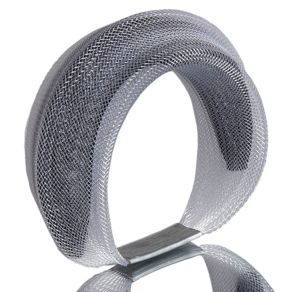 A Black and clear bracelet made from finely woven nylon mesh. A black Mesh tube is visible contained inside a clear mesh tube.