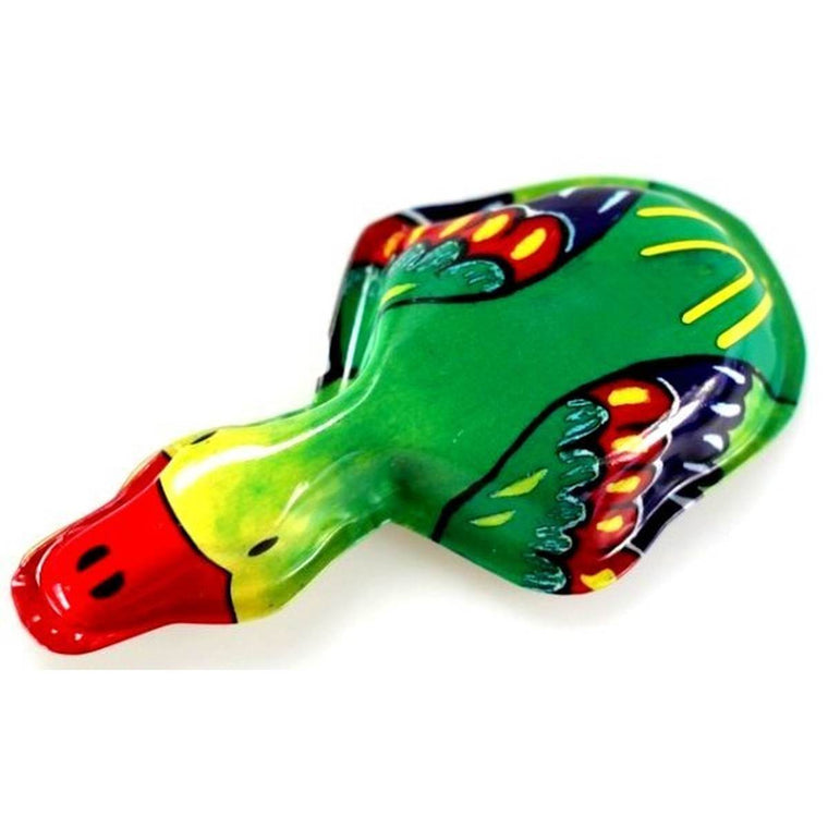 A tin toy duck featuring mostly red, green, blue and yellow colouring, viewed from above