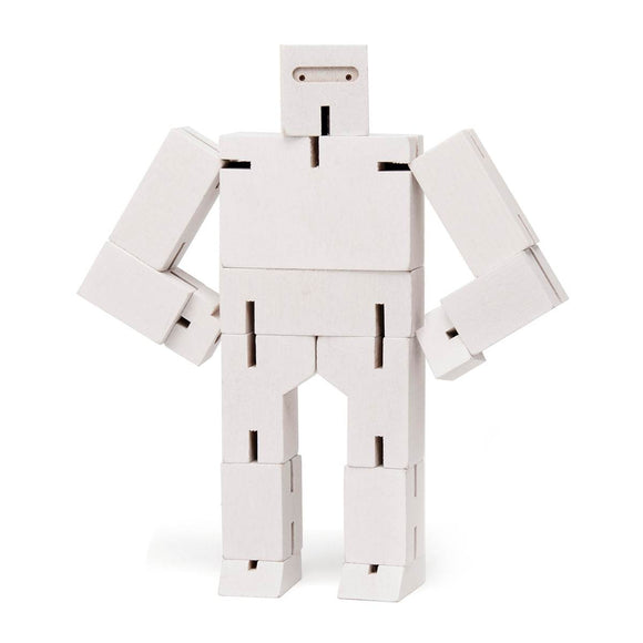 A wooden ninja robot puzzle toy made of multiple interconnected white wood pieces. Shown in a ninja pose. Shown Standing next to another robot puzzle, folded up into a cube.